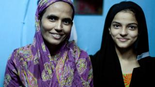 MDR-TB cured woman with her son at home in the Dharavi slum in Mumbai